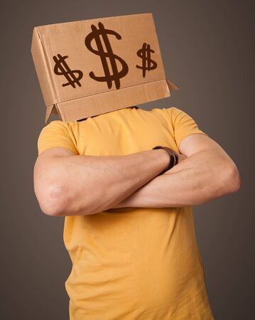 Young man standing and gesturing with a cardboard box on his head with dollar signs Stock Photo - 19351388