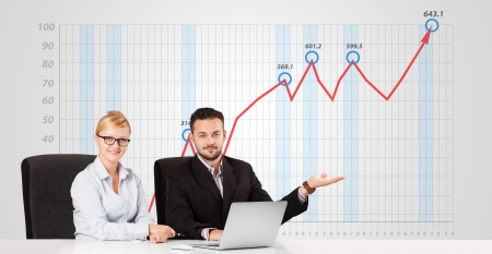 interpret: Young businessman and businesswoman calculating stock market with rising graph in the background