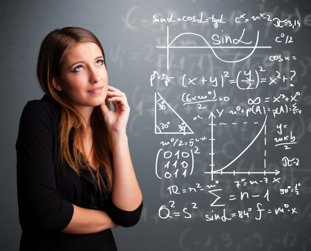 calculating: Beautiful young school girl thinking about complex mathematical signs Stock Photo