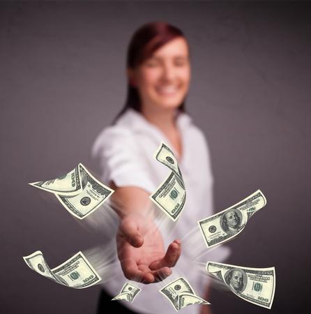 Beautiful young girl throwing money Stock Photo - 19514182