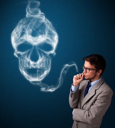 Handsome young man smoking dangerous cigarette with toxic skull smoke Stock Photo - 19514053