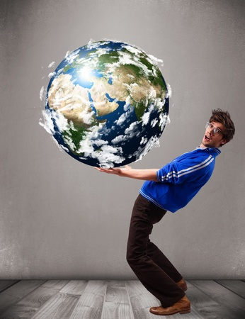 Good-looking young man holding 3d planet earth photo