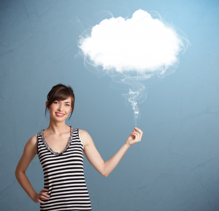 Beautiful young woman holding cloud photo