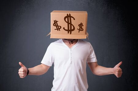 Young man standing and gesturing with a cardboard box on his head with dollar signs Stock Photo - 19435687