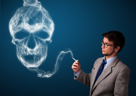 Handsome young man smoking dangerous cigarette with toxic skull smoke Stock Photo - 19539676
