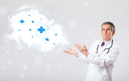 Proffesional doctor listening to abstract cloud with medical signs photo