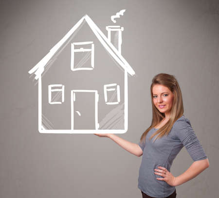 Beautiful young lady holding a huge drawn house Stock Photo - 19540200