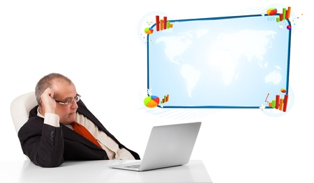 businessman sitting at desk and looking the laptop with copy space, isolated on white photo