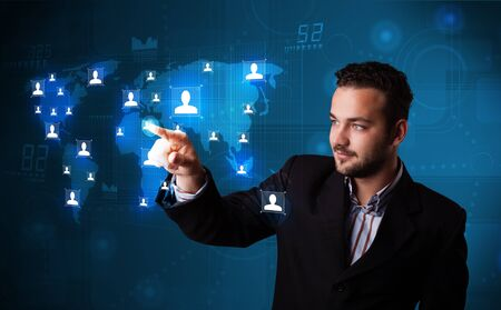 Attractive young businessman choosing from social network map photo