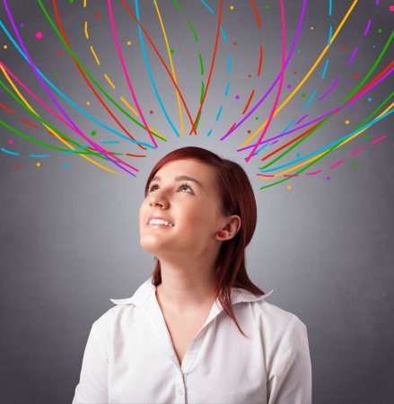 Pretty young girl thinking with colorful abstract lines overhead Stock Photo - 19654492