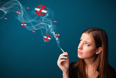 Beautiful young woman smoking dangerous cigarette with no smoking signs Stock Photo - 19664409