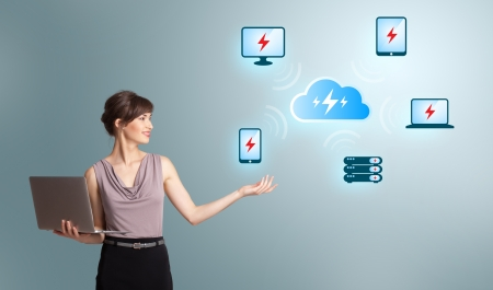 Beautiful young woman holding a laptop and presenting cloud computing network Stock Photo - 19654286