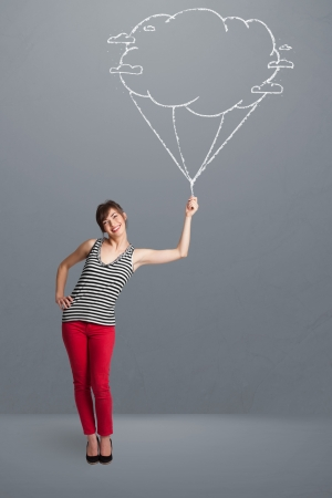 Pretty young lady holding a cloud balloon drawing Stock Photo - 19664420
