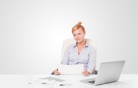 Pretty young businesswoman with plain white copy space photo