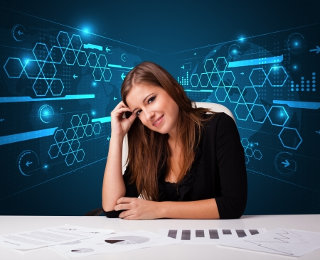 Young businesswoman doing paperwork with futuristic background photo