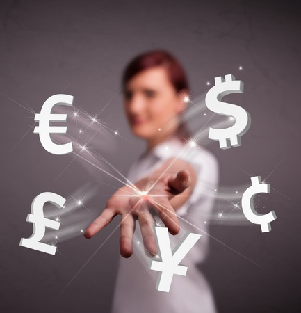 Pretty young lady throwing currency icons photo