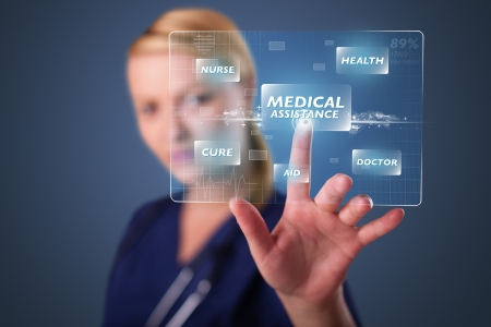 touch screen hand: Young nurse standing and pressing modern medical type of buttons Stock Photo