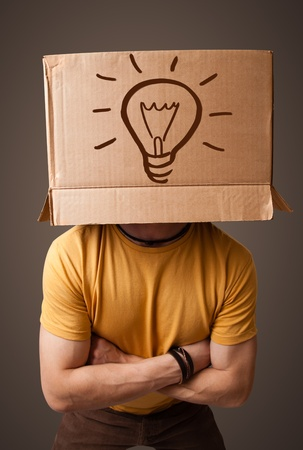 masquerader: Young man standing and gesturing with a cardboard box on his head with light bulb