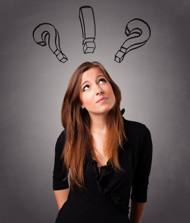 Beautiful young lady thinking with question marks overhead Stock Photo - 20524083