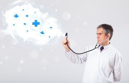 proffesional: Proffesional doctor listening to abstract cloud with medical signs
