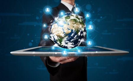 virtual world: Young businessman presenting 3d earth globe in tablet