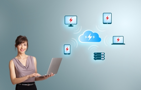 Beautiful young woman holding a laptop and presenting cloud computing network photo