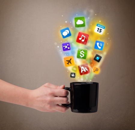 steamy: Coffee mug with colorful media icons, close up Stock Photo