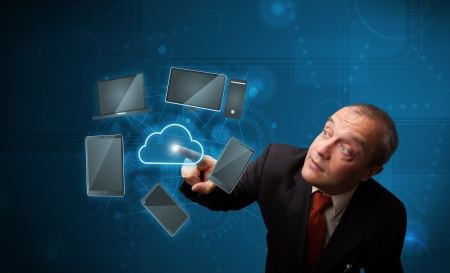 Businessman standing and touching high technology cloud service Stock Photo - 20202295