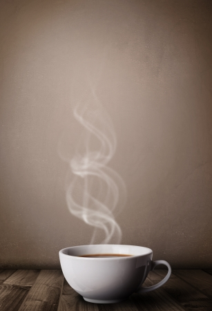 Coffee cup with abstract white steam, close up Imagens