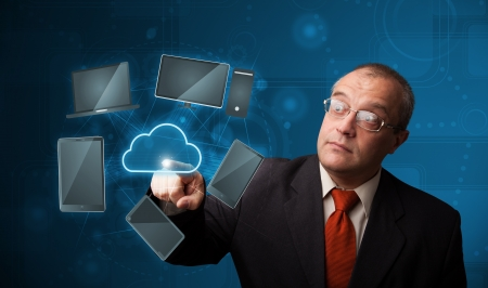 Businessman standing and touching high technology cloud service Stock Photo - 20524608