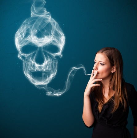 Pretty young woman smoking dangerous cigarette with toxic skull smoke Stock Photo - 20687265