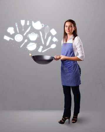 Pretty young lady with kitchen accessories icons Stock Photo - 20687269