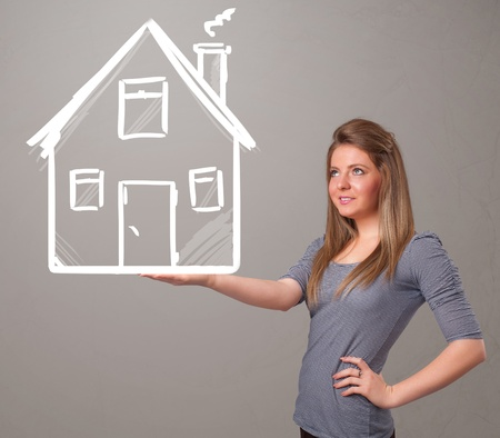Beautiful young lady holding a huge drawn house Stock Photo - 20687062
