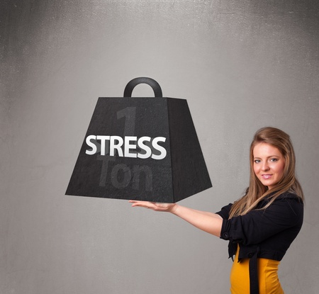 Attractive young woman holding one ton of stress weight photo