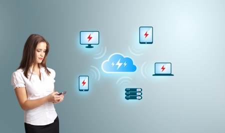 Beautiful young woman holding a phone with cloud computing network photo