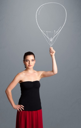 Beautiful young woman holding balloon drawing Stock Photo - 20687134