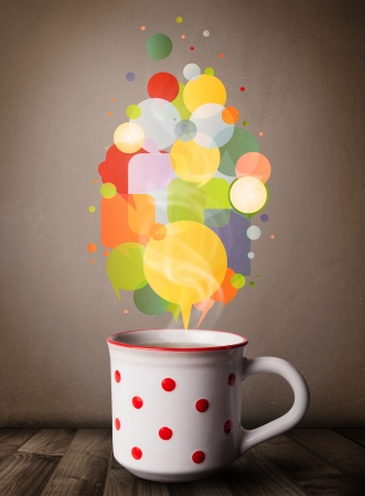 Tea cup with colorful speech bubbles, close up Stock Photo - 20661021
