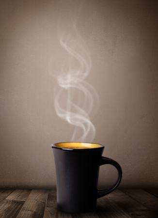 morning coffee: Coffee cup with abstract white steam, close up Stock Photo