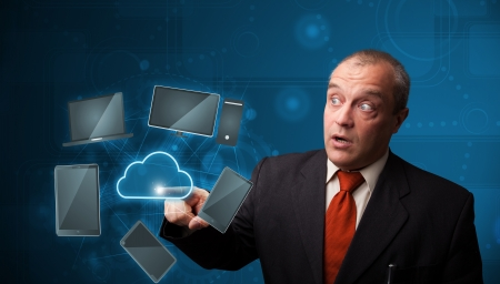 Businessman standing and touching high technology cloud service photo