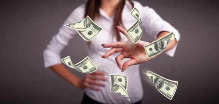 Beautiful young girl throwing money Stock Photo - 20953065