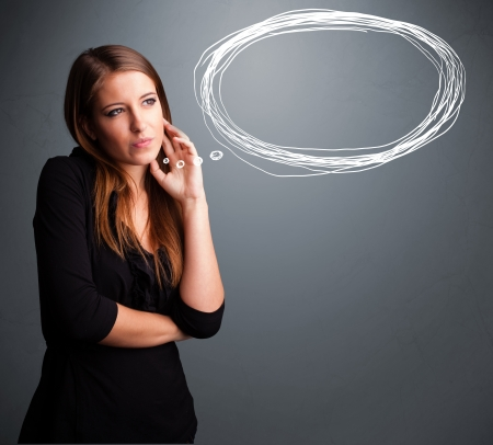 speak bubble: Beautiful young lady thinking about speech or thought bubble with copy space Stock Photo