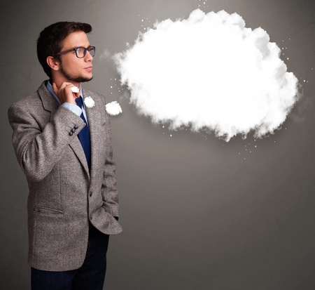 theorize: Good-looking young man thinking about cloud speech or thought bubble with copy space Stock Photo