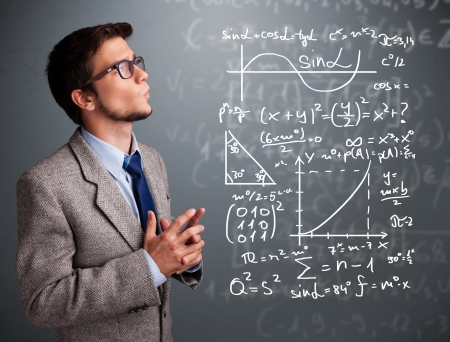 Handsome young school boy thinking about complex mathematical signs photo