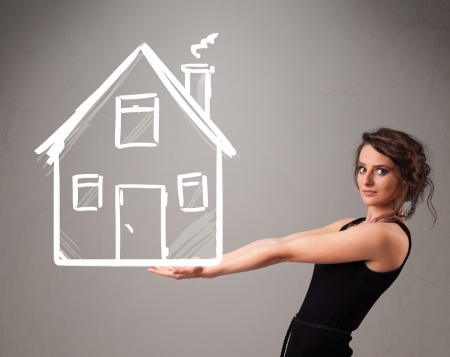 Beautiful young lady holding a huge drawn house Stock Photo - 21017843