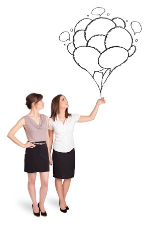 Happy young women dolding balloons drawing photo