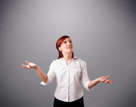 juggling: beautiful young lady standing and juggling with copy space