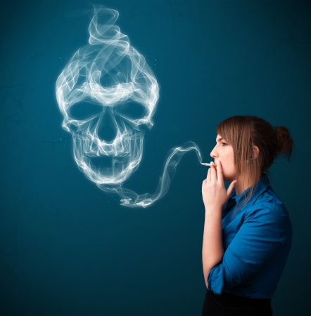 Pretty young woman smoking dangerous cigarette with toxic skull smoke  Stock Photo - 21160901