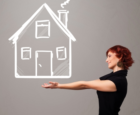 Beautiful young lady holding a huge drawn house Stock Photo - 21150674