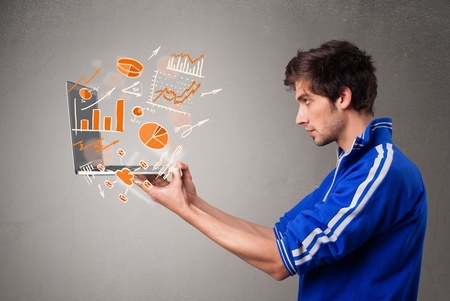 Handsome young man holding laptop with graphs and statistics Stock Photo - 21160912