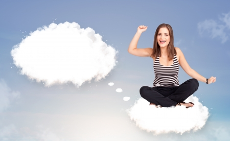 Pretty young girl sitting on cloud and thinking of abstract speech bubble with copy space Stock Photo - 21160916